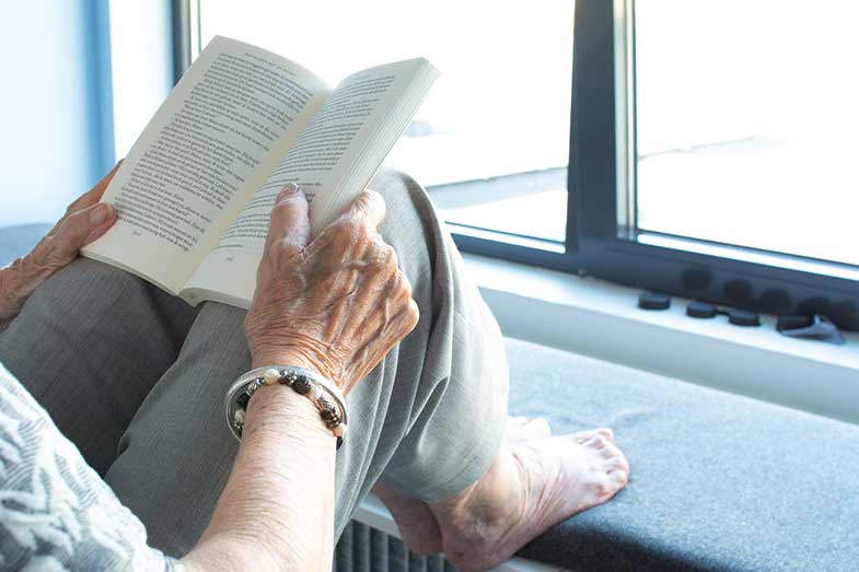 Aged Person Reading a Book