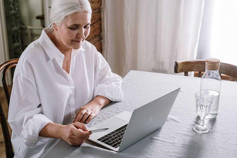 An Older Woman Using a Laptop