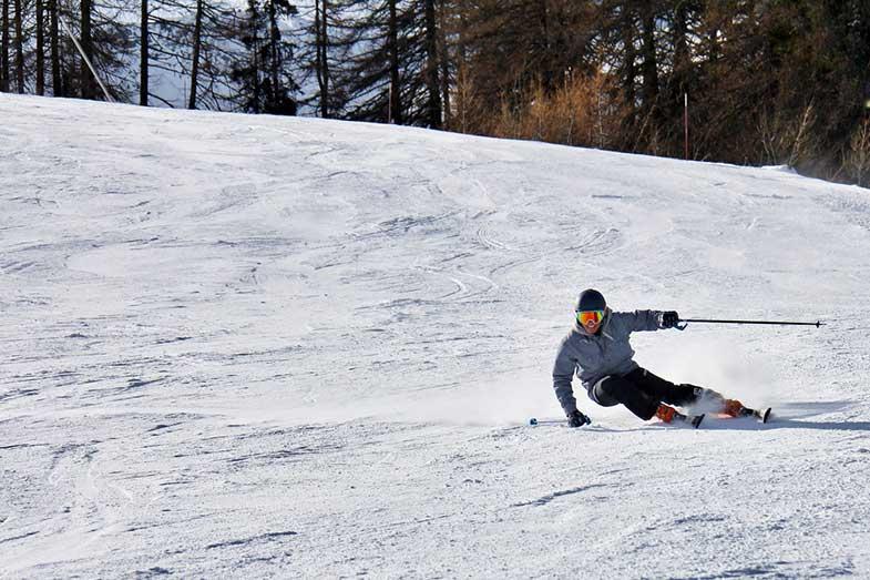 Person Skiing Fast on Ski Run