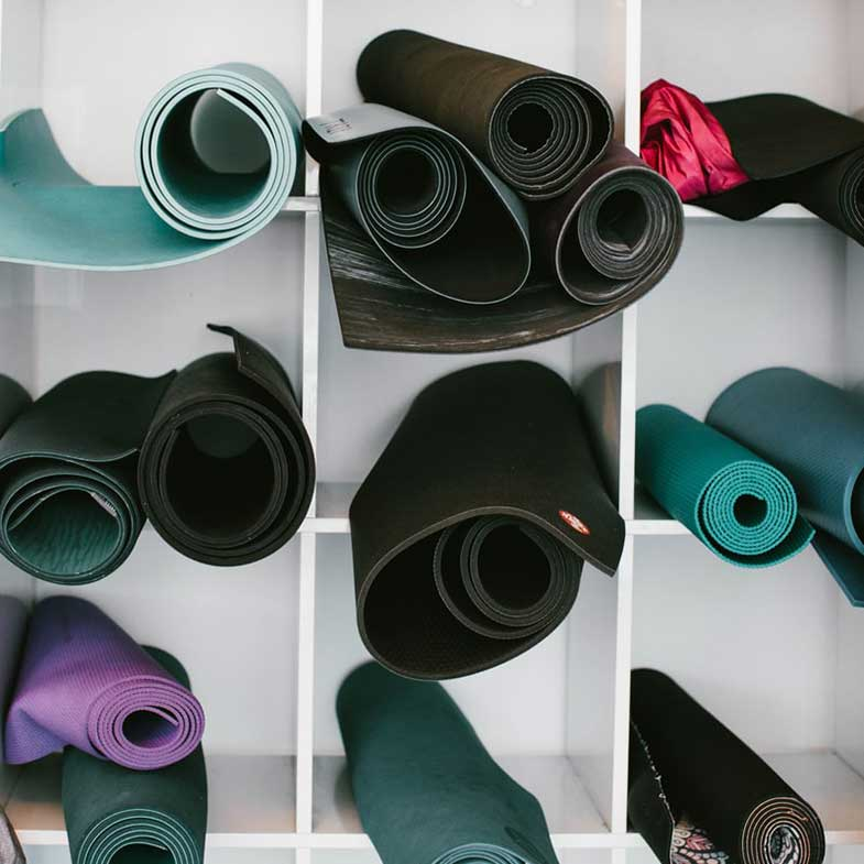 Colorful Yoga Mats in Shelf
