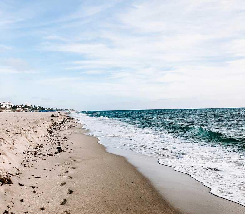 Florida Beach Ocean Under Cloudy Sky