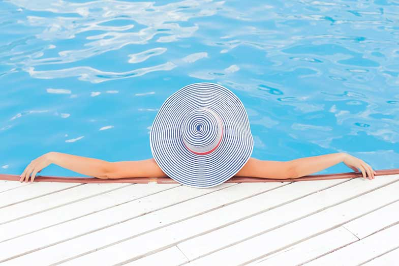 Person Leaning on Pool Wall