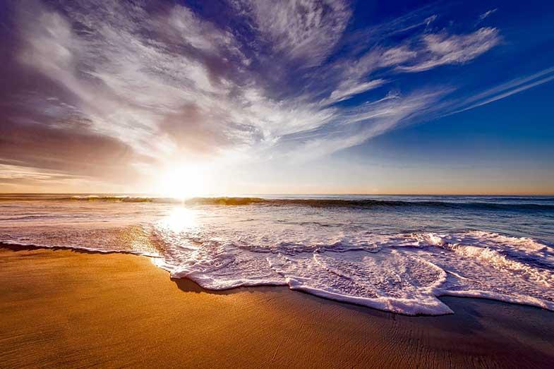 Seashore Under White and Blue Sky