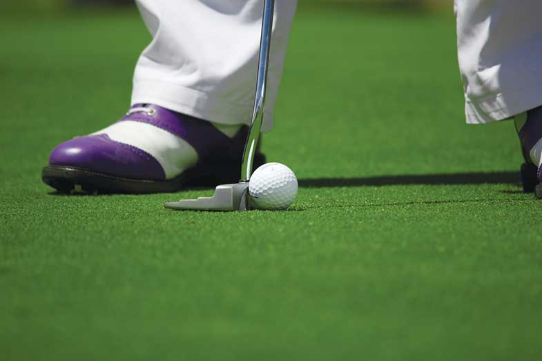 Golfer with White Pants on the Putting Green