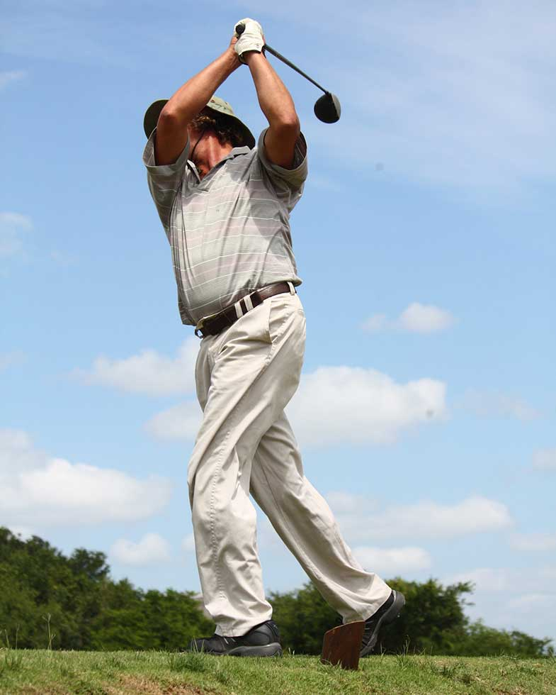 Person in Gray Polo Shirt Playing Golf