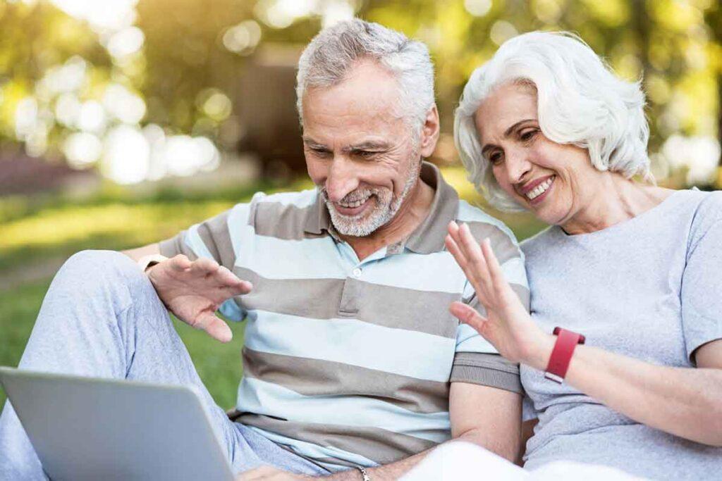 Elderly Couple Using Laptop Computer