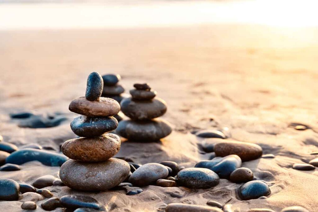 Pile of Balanced Rocks on a Beach